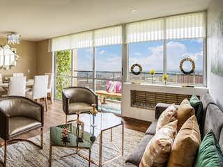 Una sala de estar llena de muebles y una ventana en La Felicidad - La Reserva