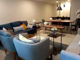 Una sala de estar llena de muebles y una mesa en Anaxágoras 836