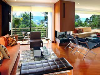 Una sala de estar llena de muebles y una televisión de pantalla plana en Ventto