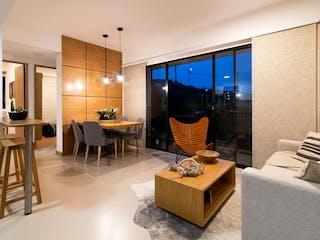 Una sala de estar llena de muebles y una televisión de pantalla plana en Guayacán