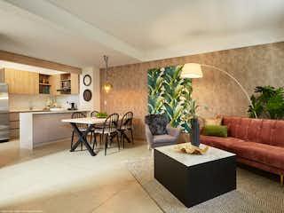Una sala de estar llena de muebles y una planta en maceta en Llano Azul Casas