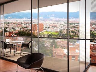 Una vista de una ciudad desde una ventana en Cerros de Sotileza