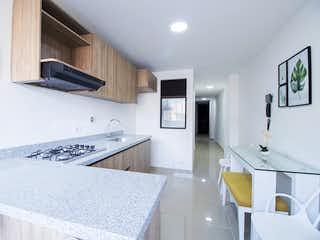 Una cocina que tiene un fregadero y una estufa en ella en Zafiro