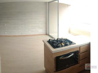Una estufa encima del horno sentado dentro de la cocina en  Alcala de henares