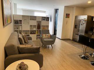 Una sala de estar llena de muebles y una televisión de pantalla plana en Tekto Las Flores