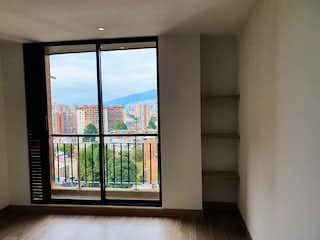Una ventana que está en una habitación con una ventana en Cedritos 147