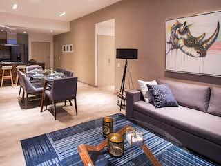 Una sala de estar llena de muebles y una mesa en Residencial Las Flores 2020