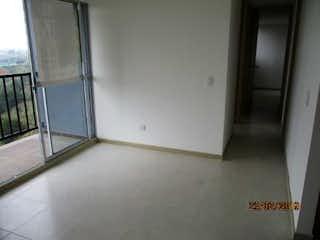 Un refrigerador congelador blanco sentado en una cocina en Apartamento en venta en Fontibón de tres alcobas
