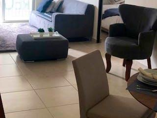 Una sala de estar llena de muebles y una televisión de pantalla plana en Departamento en venta en Ermita, de 69mtrs2