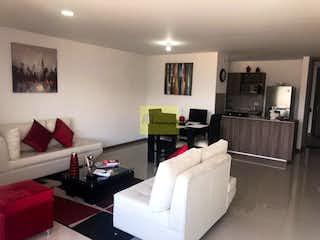 Una sala de estar llena de muebles y una televisión de pantalla plana en  Apartamento en venta en  La Abadía  de 90mt2