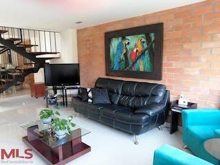 Una sala de estar llena de muebles y una televisión de pantalla plana en Magallanes