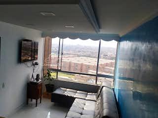 Una sala de estar llena de muebles y una ventana en Apartamento en venta en Engativá Pueblo de 45 mts2