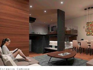 Un grupo de personas sentadas en una sala de estar en San Lorenzo 909