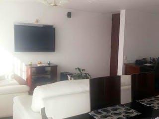 Una sala de estar llena de muebles y una televisión de pantalla plana en Conjunto Santafe Pijao