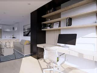 Una sala de estar con un sofá, un televisor y una mesa en Alenta Apartasuites