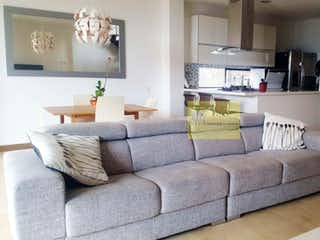 Una sala de estar llena de muebles y una televisión de pantalla plana en OLIVO DE LA CALLEJA