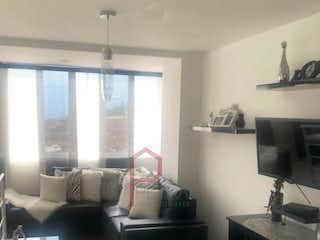 Una persona sentada en una silla en una sala de estar en Apartamento en venta en Belén Centro, de 100mtrs2