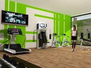 Una sala de estar llena de muebles y una televisión de pantalla plana en Manzana Verde
