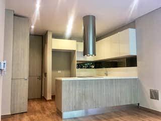 Un cuarto de baño con lavabo de bañera y espejo en Apartamento en venta en Rosales de dos habitaciones