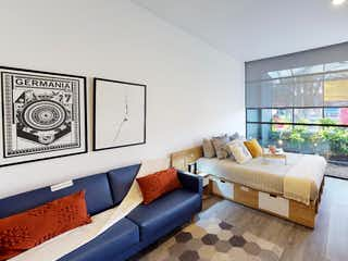 Una sala de estar llena de muebles y una ventana en 33 DC