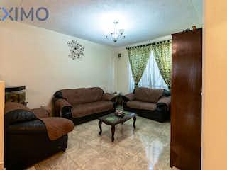 Una sala de estar llena de muebles y un sofá en Casa en venta en La Draga con Jardín...