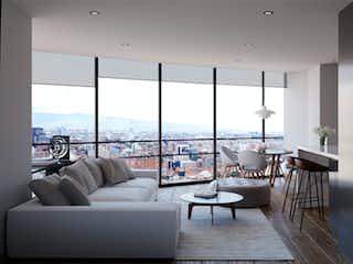 Una sala de estar llena de muebles y una gran ventana en Aluna