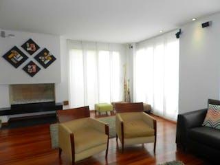 Una sala de estar llena de muebles y una televisión de pantalla plana en Conjunto Rincon La Floresta