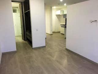 Una cocina con nevera y fregadero en Apartamento en venta en Bosque Izquierdo de una habitacion