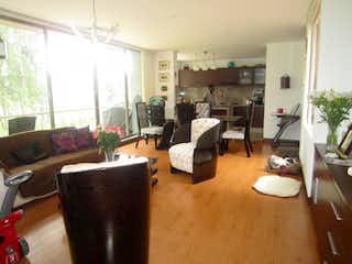 Una sala de estar llena de muebles y una televisión de pantalla plana en Agrupacion Caminos De Arrayanes