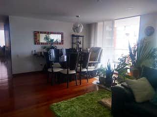Una sala de estar llena de muebles y una televisión de pantalla plana en Conjunto Residencial Miro