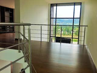 Una vista de una habitación con una puerta de cristal en Aquarela