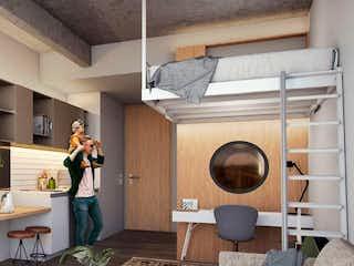 Una mujer de pie en una cocina junto a un microondas en Next Living