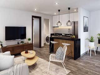Una sala de estar llena de muebles y una televisión de pantalla plana en Urban Club Aptos