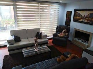 Una sala de estar llena de muebles y una chimenea en Conjunto El Valle
