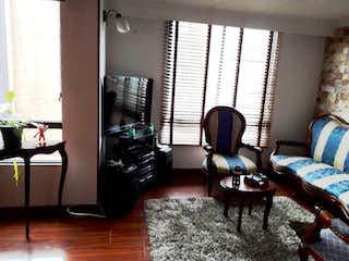 Una sala de estar llena de muebles y una chimenea en Apartamento en venta en Morato, de 62,68mtrs2