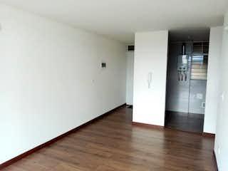 Una cocina que tiene un refrigerador en ella en Apartamento en venta en  San Pablo de 3 habitaciones
