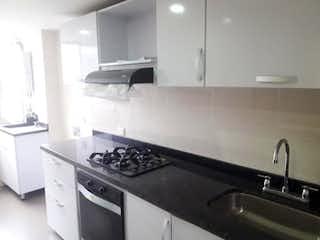 Una cocina con una estufa de fregadero y horno en Apartamento en venta en  Bonanza, de 62,2mtrs2