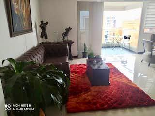 Una sala de estar llena de muebles y una chimenea en Apartamento en venta en  Zuñiga de 3 habitaciones