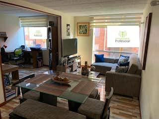 Una sala de estar llena de muebles y una televisión de pantalla plana en Apartamento en venta en Gran Granada, de 66mtrs2