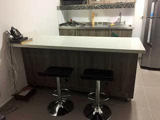 Una foto en blanco y negro de un lavabo de baño en Apartamento en venta en La Aldea de tres habitaciones