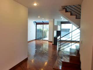 Una vista de una sala de estar con un gran ventanal en Casa en venta en Casa Blanca Suba de 194mts, tres niveles