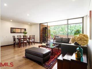 Una sala de estar llena de muebles y una televisión de pantalla plana en Santos