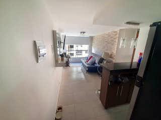 Una sala de estar llena de muebles y una ventana en TRIGALES