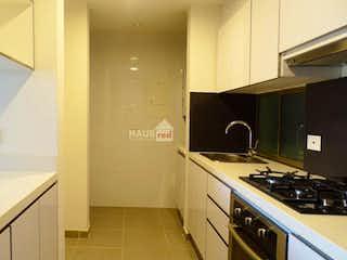 Una cocina con una estufa de fregadero y nevera en Apartamento para estrenar en ciudad salitre
