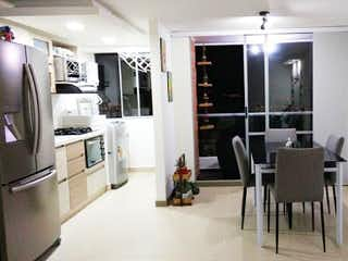 Una sala de estar llena de muebles y una chimenea en Apartamento en venta en La Cuenca, de 65mtrs2