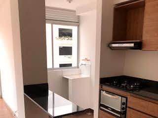 Una cocina con una estufa, un fregadero y una estufa en Apartamento en venta en El Trapiche, de 72mtrs2