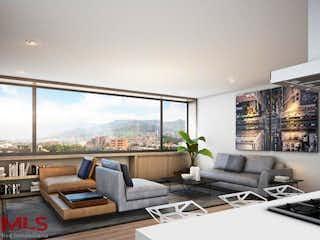 Una sala de estar llena de muebles y una gran ventana en Go Living & Suites