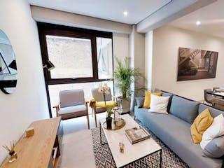 Una sala de estar llena de muebles y una televisión de pantalla plana en CYTA Condesa