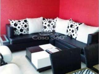 Una sala de estar llena de muebles y una gran ventana en Apartamento en venta en  Villa Magdala de 3 habitaciones