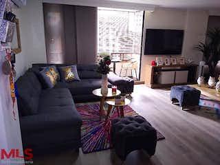 Una sala de estar llena de muebles y una televisión de pantalla plana en Laureles